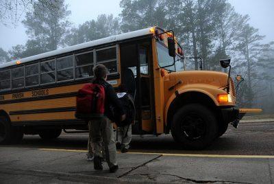 Children entering the school bus