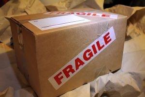 Cardboard box with a big fragile label on it