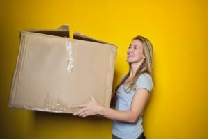 A girl with a moving box