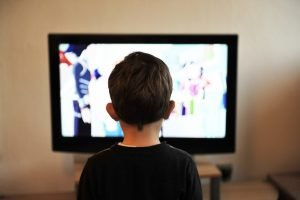Picture of a kid watching TV