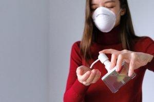 Woman applying hand sanitizer