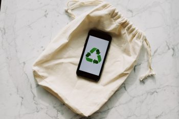 Bag with a phone that promotes recycling.