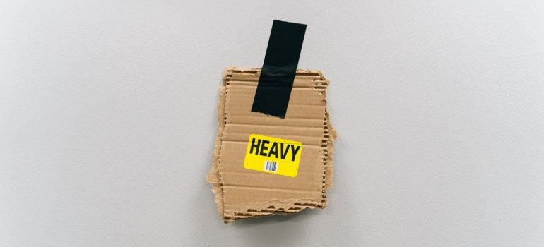 A label on a piece of cardboard that belongs to some packing supplies you need for a move.