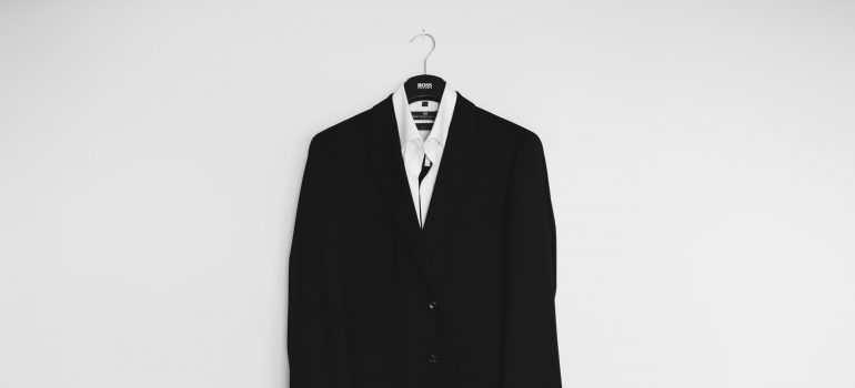 A suit as a reason as to why you are reading our solutions for packing your wardrobe.