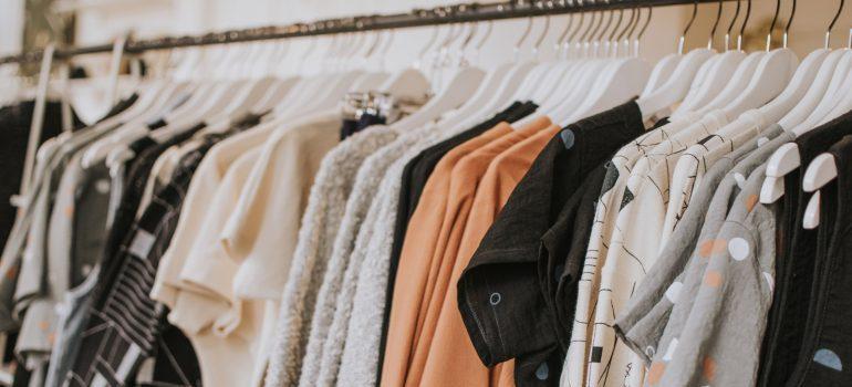 Clothes in a closet.