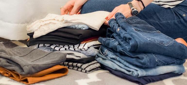 A person folding clothes.