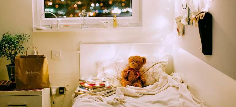A teddy bear on the bed.