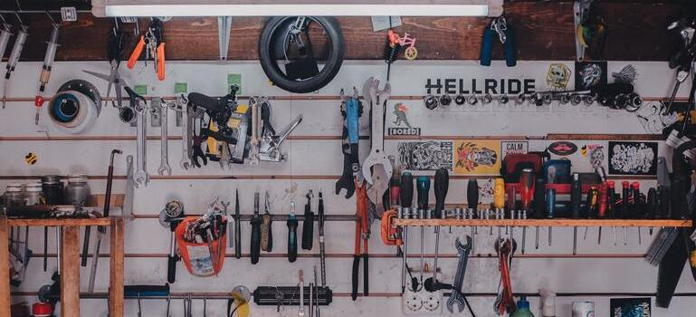 Tools on the wall you will have to handle when you pack your garage items.