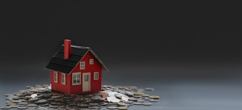 A small house and some coins.