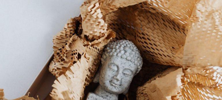 A Buddha sculpture in a box.