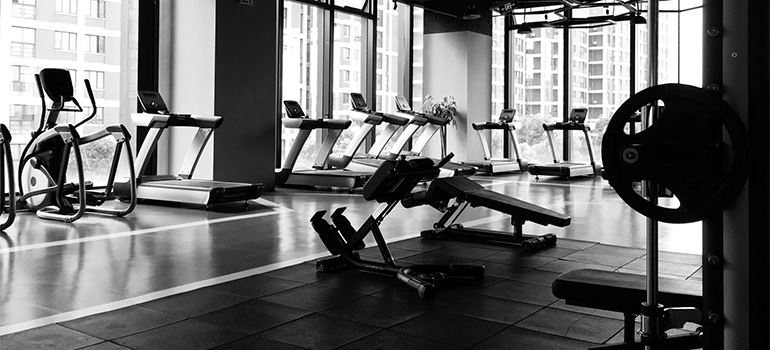A gym with plenty of sports equipment