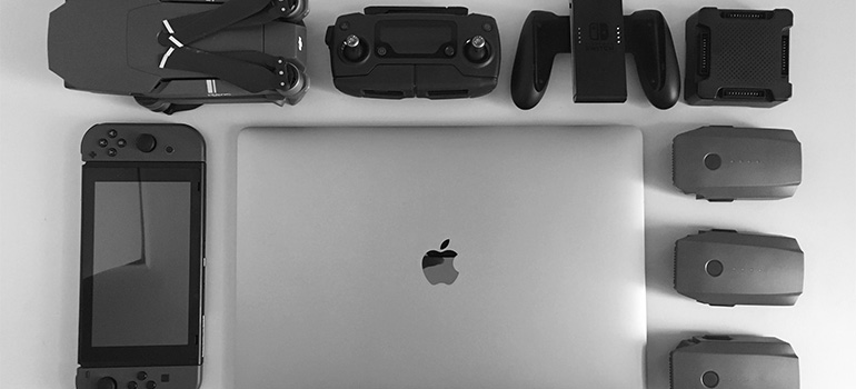 Various devices on a white surface.