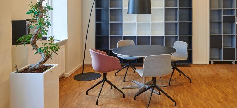A table surrounded by chairs in an office.