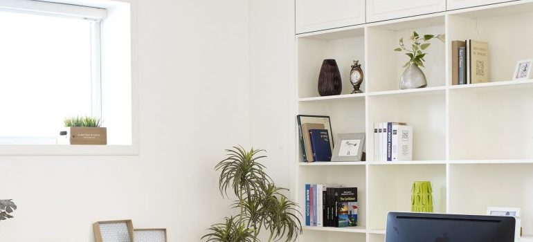 An apartment with a shelves and decorations.