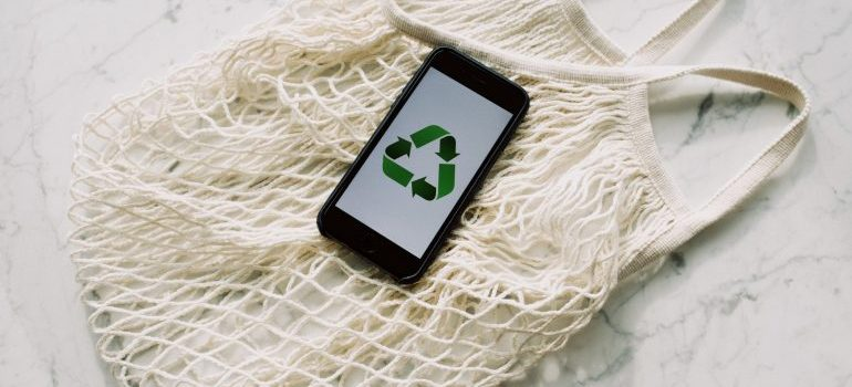 An eco-friendly sign on a phone.