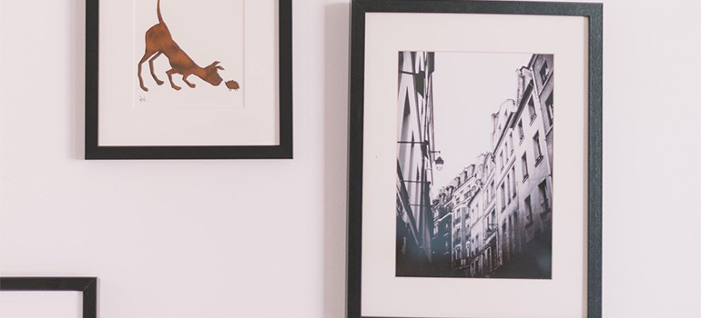 Pictures in frames on a white wall
