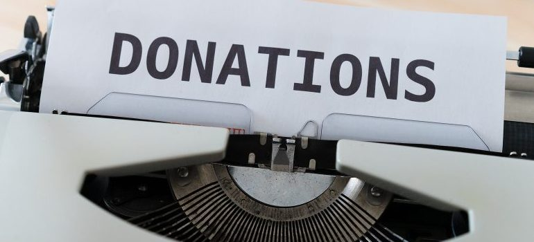 """donations"" on typing machine"