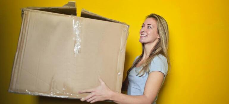 girl holding a box for packing during holidays