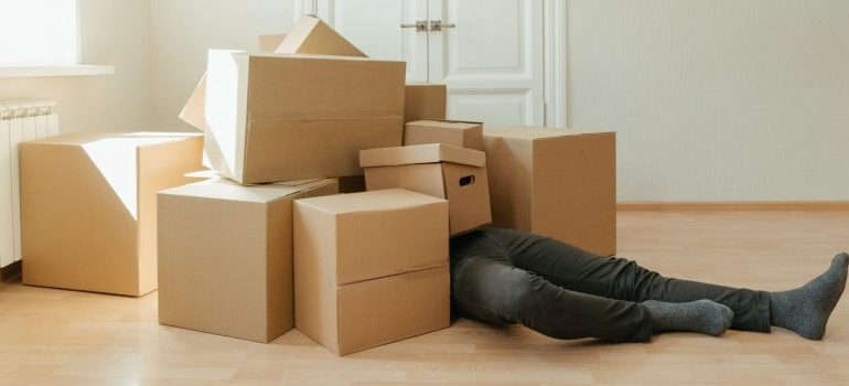 A man and carboard boxes.