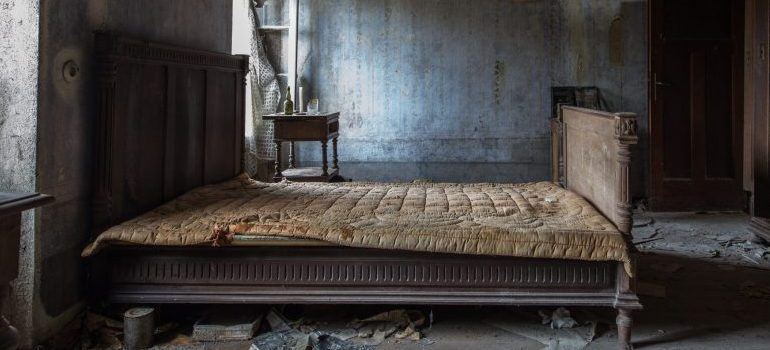 old bed in abandoned house