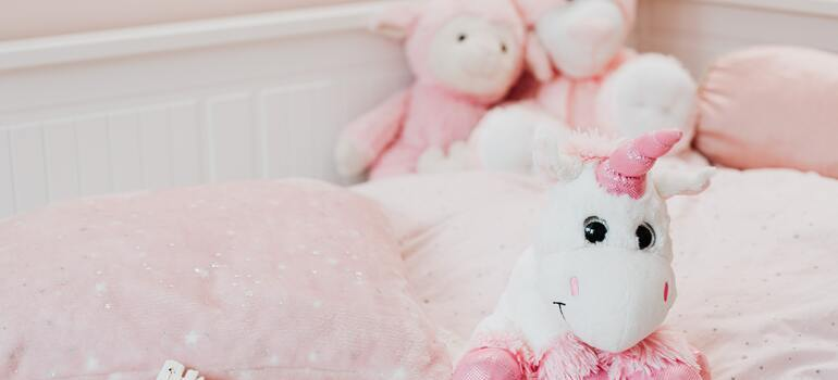 A white unicorn stuffed toy