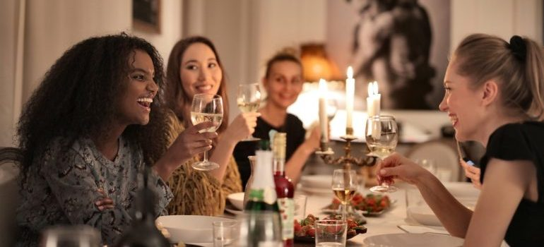 Girls sitting together as one of the 5 cool ways to meet your new neighbors.