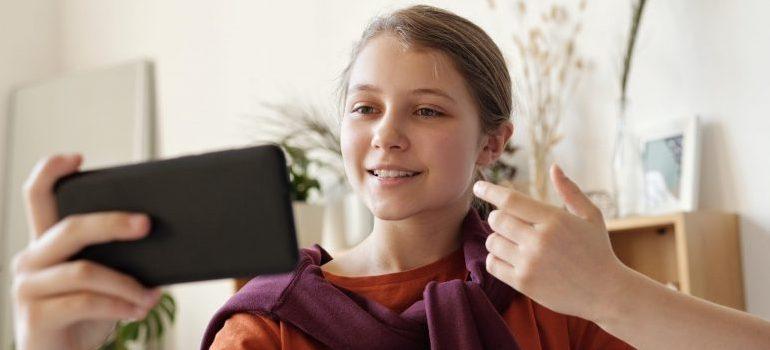 teenage girl using a phone