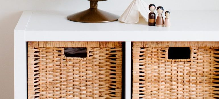 -hidden storage ideas shown through boxes in shelves