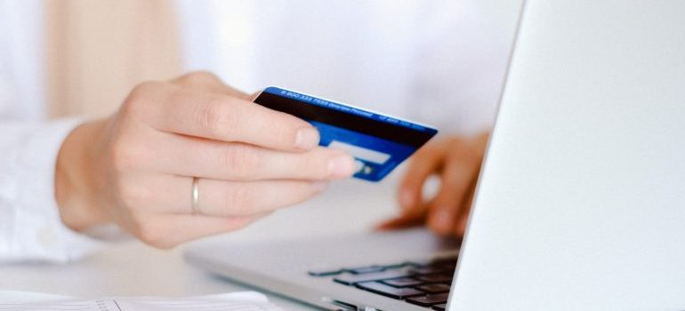 person shopping online, using a credit card