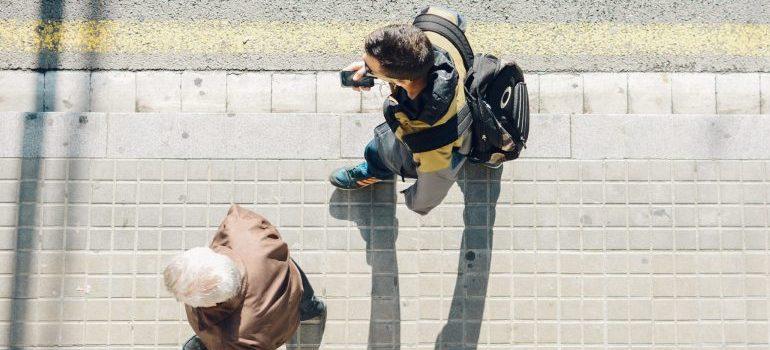two people walking, sidewalk