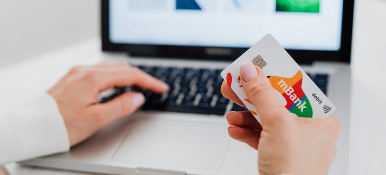 A woman holding a credit card.
