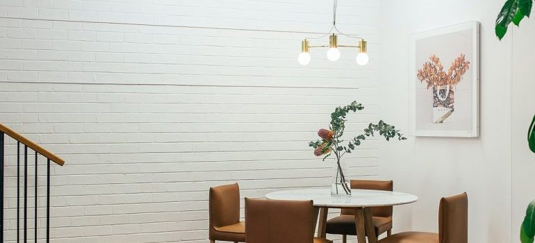 Chairs and a table in front of a wall.