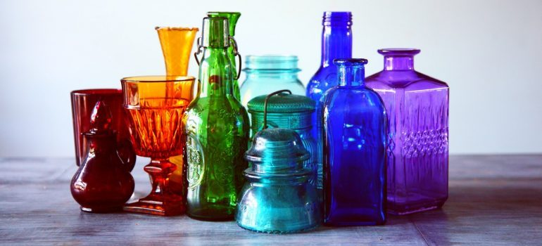 Assorted color translucent glass containers
