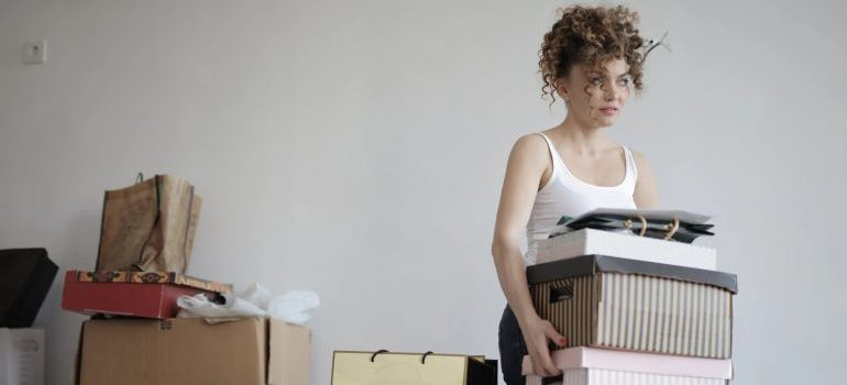 women decluttering her home