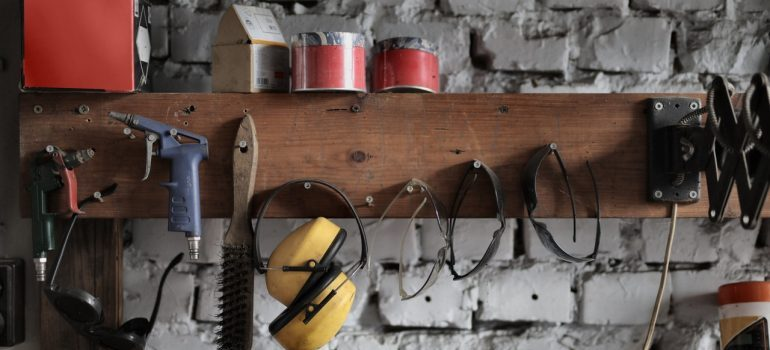 Different tools hanging on a rack.