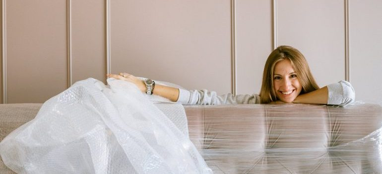 woman using rented moving supplies