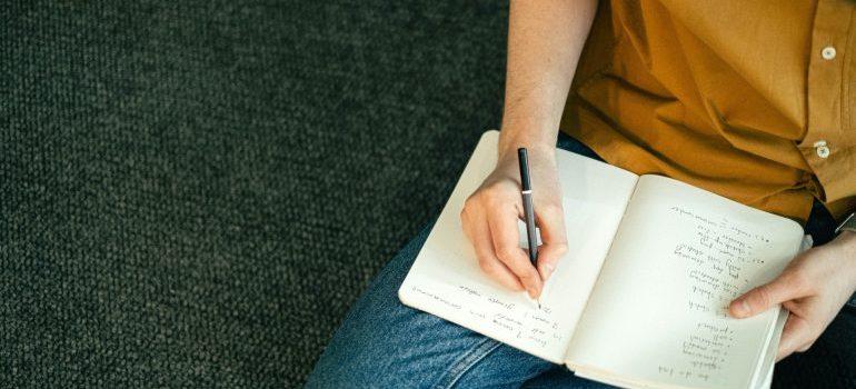 Man writing a to do list.