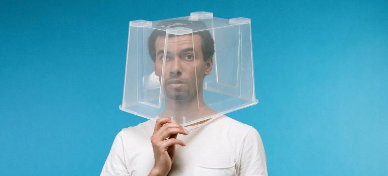 Plastic bin on a guy's head