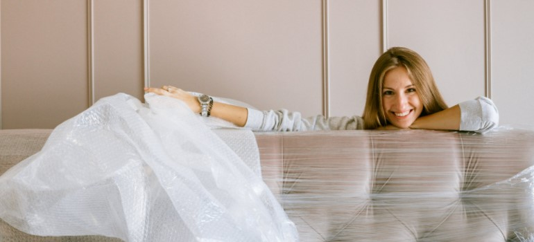 Woman wrapping a sofa