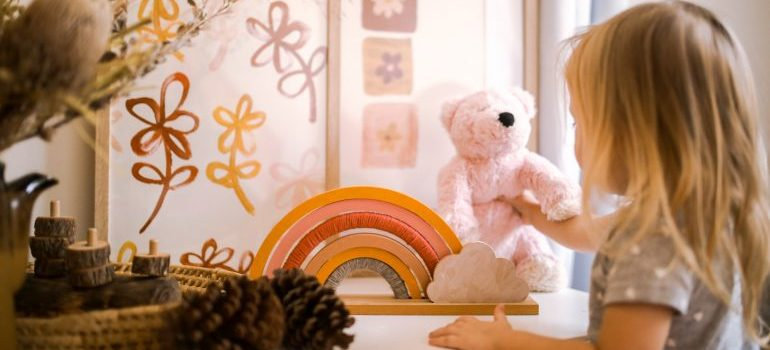 A kid playing with a toy in the kid's room.