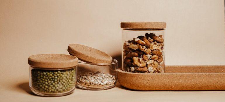 Three jars wirh seeds and grains.
