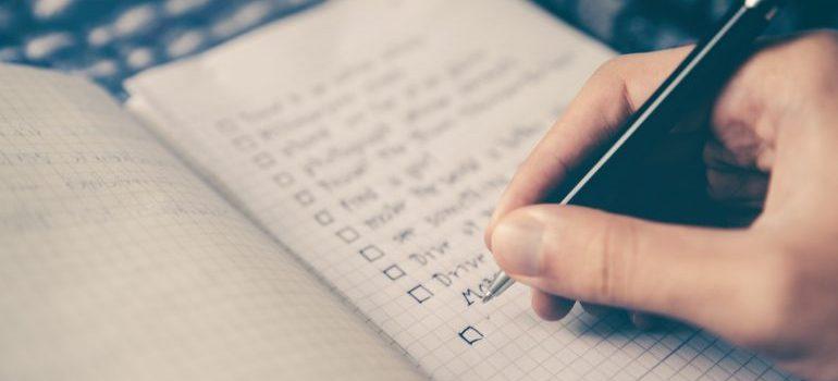 Woman writing a checklist.