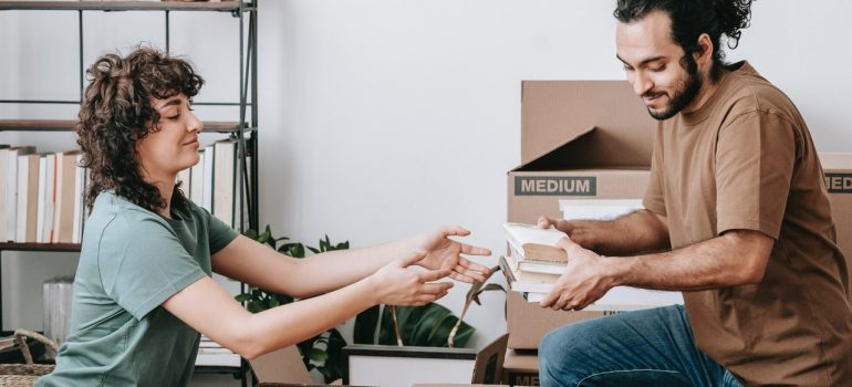 a couple packing their items after consulting with packing tips from a professional