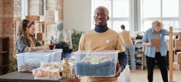 Young man holding a plastic box
