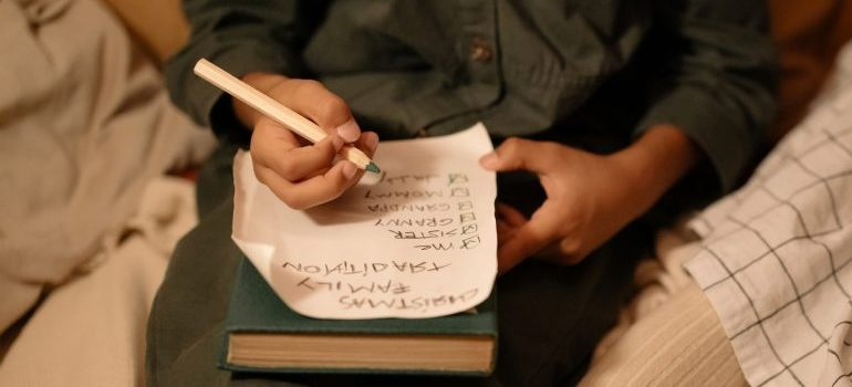 Man writing in his checklist.