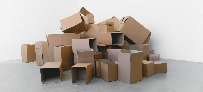 Cardboard boxes laying on the floor.